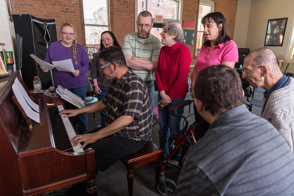 piano instructor leading singing with people with intellectual disabilities