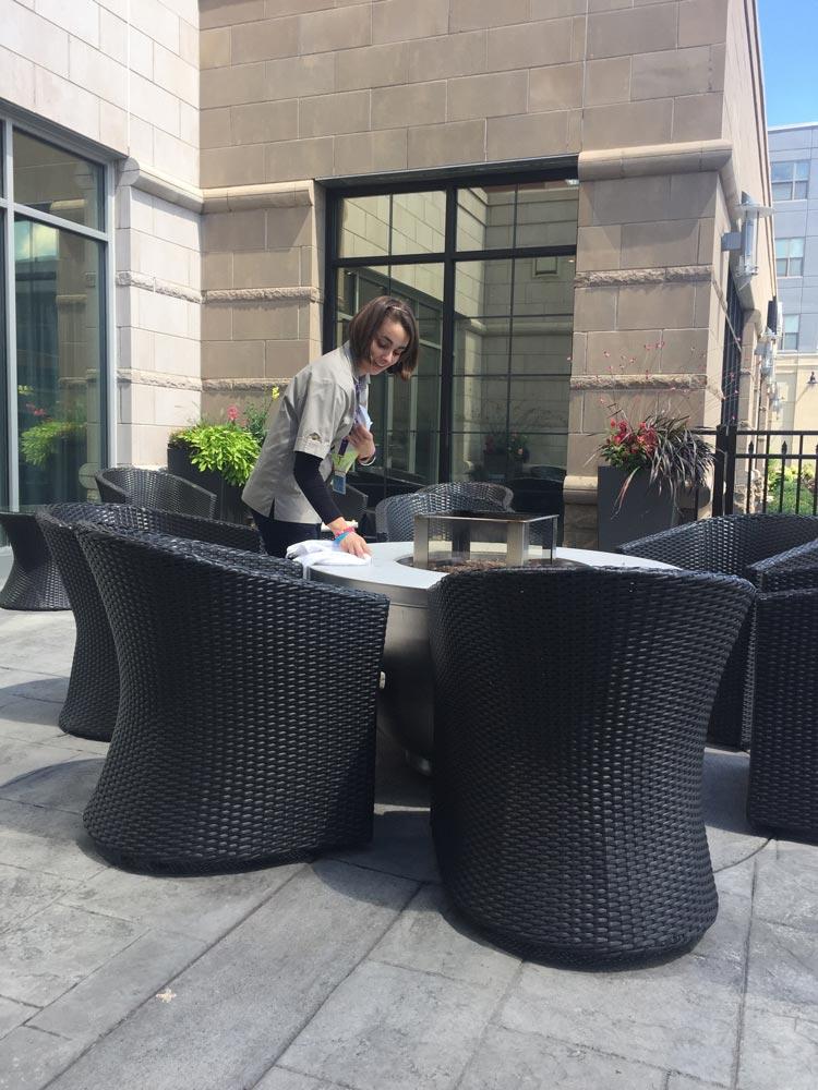 Girl wiping table