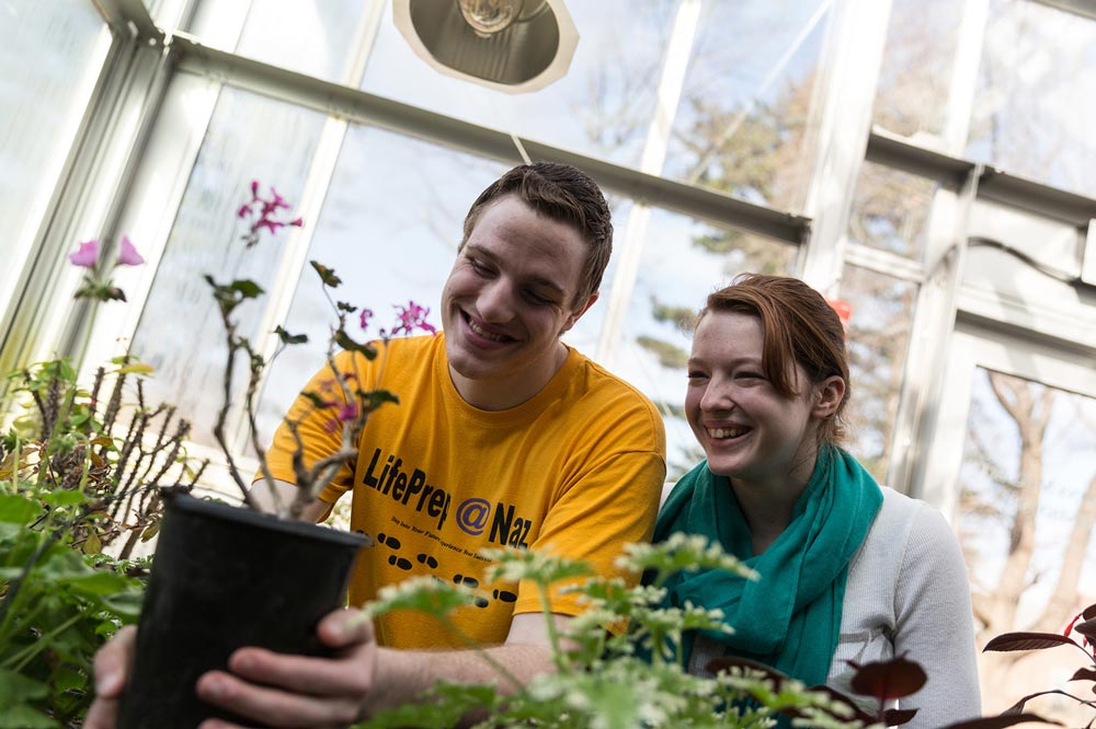 young man and woman in greenhouse at Nazareth College
