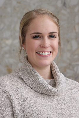 woman with blonde hair and tan sweater